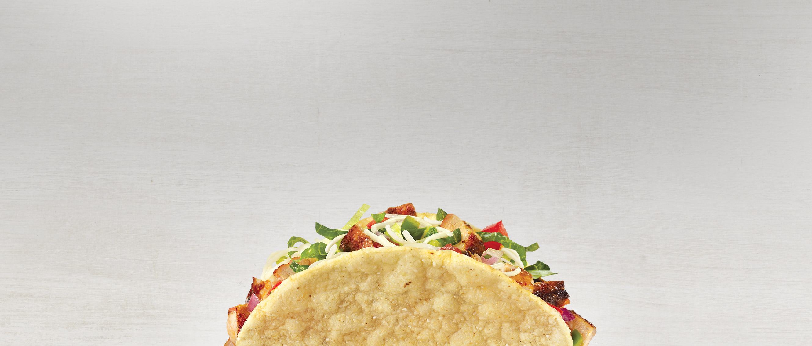 An image of a single crispy-shell chipotle taco.